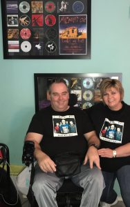 john and madie in front of oils cds photo and we present our wheelchair travel tips