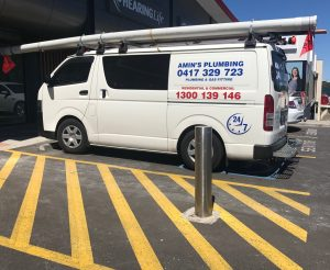 amin's plumbing - in an accessible car park and no permit- so much for wheelchair accessibility