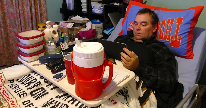ready for the night, john uses his ipad