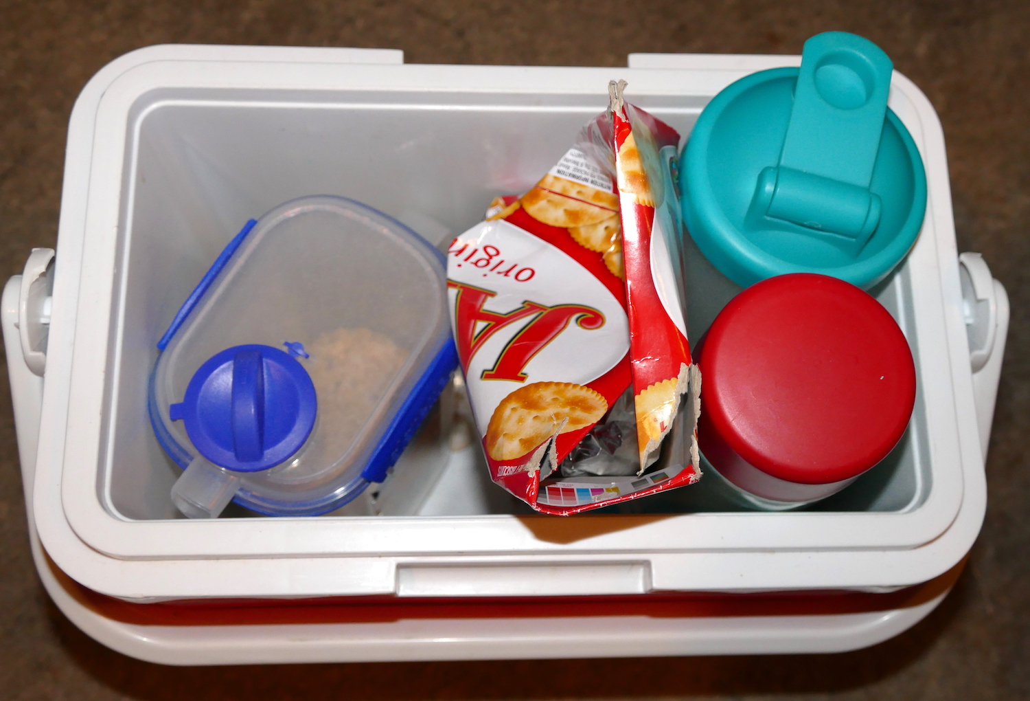 the esky contains hot water, jatz biscuits, cereal, empty shaker bottle