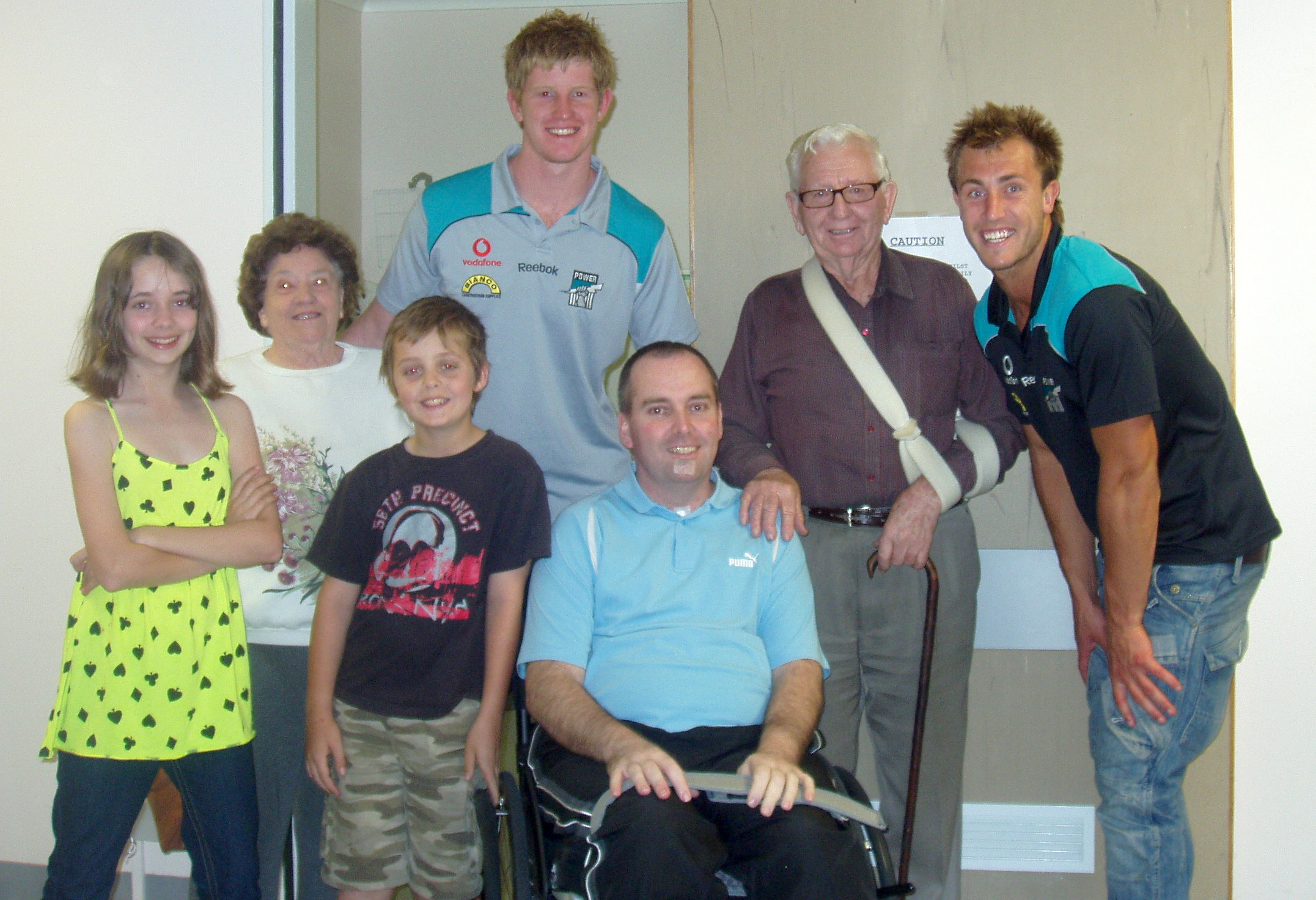 john, his dad, jasmine and ben and his mum are photographed with power players Matt Thomas and Matthew Lobey