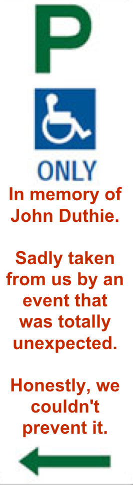 the accessible parking sign that reads 'in memory of john duthie. Sadly taken from us by an event that was totally unexpected. Honestly, we couldn't prevent it. Very close to the site of the fallen tree