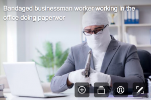 disability stock photographs - man in business suit and dressed as a mummy too holding a gun which is rediculous