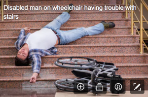 disability stock photographs - man laying on the steps, appears he tried to go down them in a wheelchair