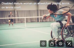 disability stock photographs - a woman playing tennis in a wheelchair