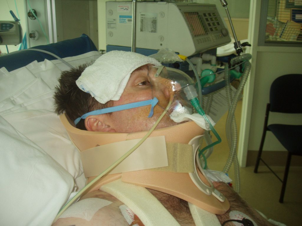 Wheelchair Blog - In ICU with a neck brace, many tubes and equipment