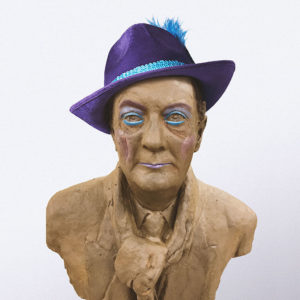 an ugly bust of peter goers (accurate though) wearing a purple hat. Adelaide Fringe Accessibility