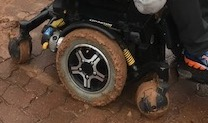 mud is coated on all 3 wheels of my powered wheelchair - RAA wheelchair road service