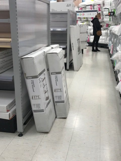 At Kmart there are 2 rows shown. Normally there is room for wheelchairs to get around, but the photo shows large boxes blocking access. Scentre Group accessibility needs to improve