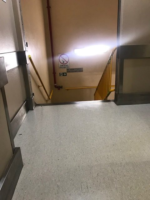 The accessible toilets are to the right. Ahead are the stairs. Lack of safety. Scentre Group accessibility needs to improve.