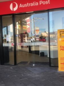 the front doors of the PO area - a new shiney sliding see through door