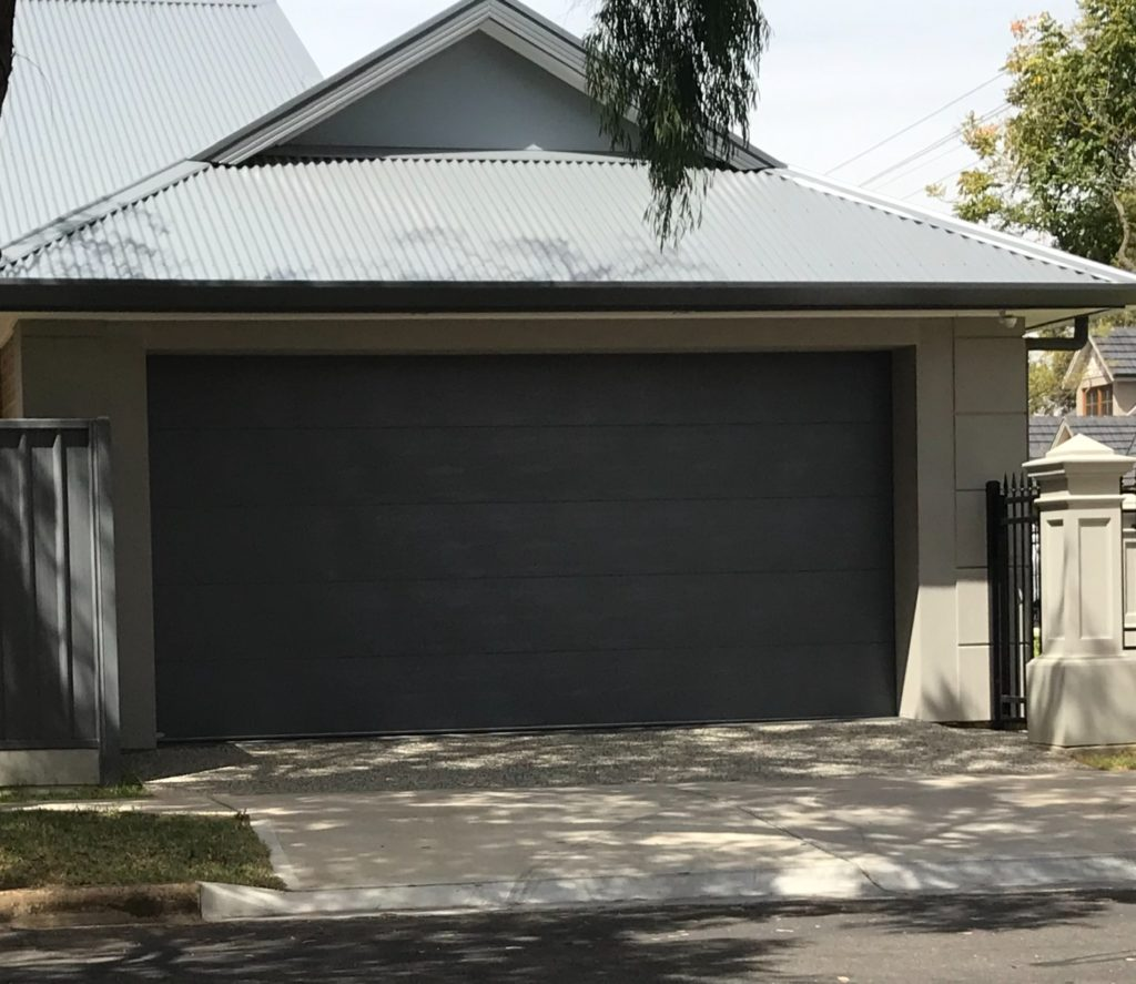 A newly built double garage. WIth double driveway and cross over.