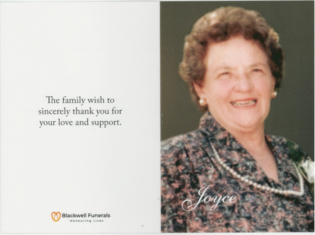 The memorial card of Joyce Dorothy Duthie. It shows a photo of Joyce with a big smile, and pearl necklace, taken at the wedding of her son. It reads 'The family wish to sincerely thank you for your love and support'