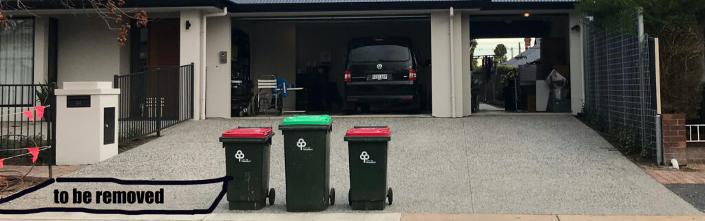 my driveway with 3 council bins on it. One of the sections of driveway is to be removed. Prospect Council Accessibility!