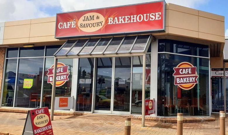 a a frame sign out the front, a huge sign above the door, lots of glass windows, and a double door. It is the cafe bakehouse. Sefton Plaza Accessibility
