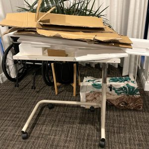 cardboard on top of foam, sitting on a table with wheels - Building furniture from a wheelchair